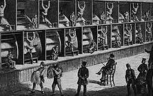 """Die Tretmühle – Nachdem die großen Grundbesitzer durch das System der """"Einhegungen"""" die englischen Bauern von der Scholle vertrieben hatten, wurden diese zur Flucht in die Städte gezwungen. Soziale Fürsorge gab es nicht; wer straffällig wurde, verfiel unbarmherzig den brutalen Methoden der Strafvollstreckung. Kein Wunder, dass viele es unter diesen Umständen vorzogen, sich in die Kolonien verschicken zu lassen. - Aus """"Le Monde Illustrd"""" (1867)."""